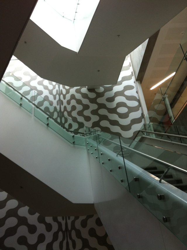 Staircase with medical imaging pattern behind