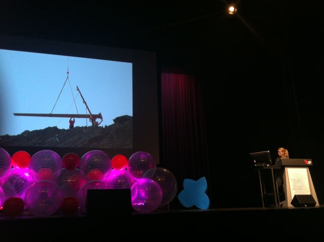 Kathrin Aste discussing a helicopter constructed mountain viewing platform
